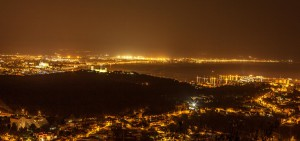 Genova property market night view.