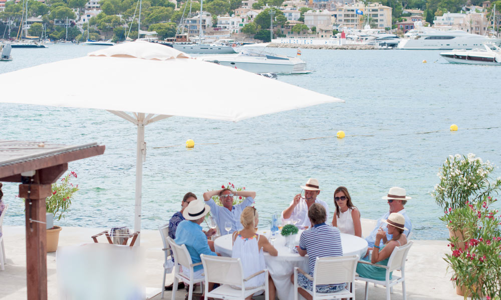 Port Andratx property buyers enjoying a great time next to the marina.
