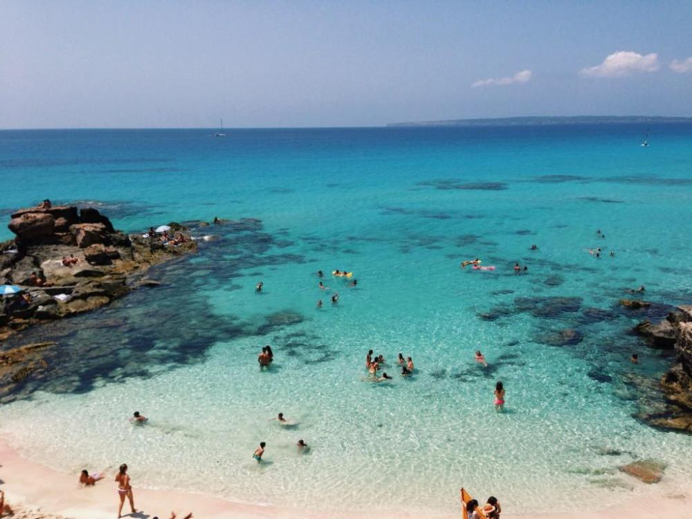Formentera property buyers enjoy white sand beaches and crystal clear waters of Mediterranean Sea.