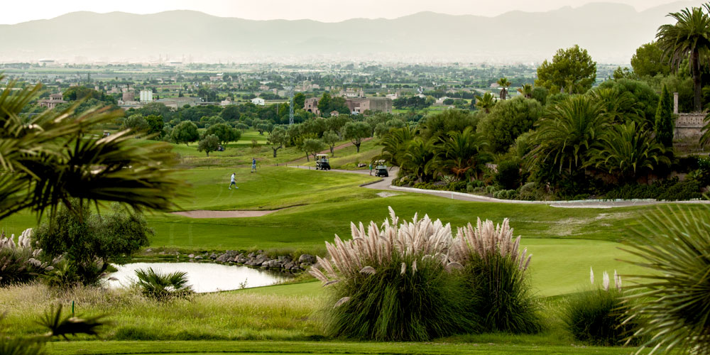 Son Gual Gold platz course view from Club House with cafe and restaurant bistro view over Palma de Mallorca lakes players real estate neighbourhood guides Casafari