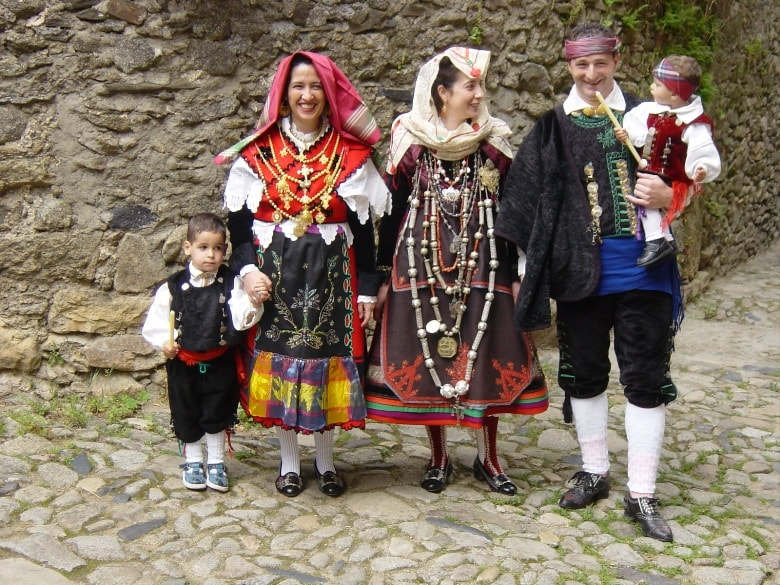 Spanish family in traditional costumes fiesta Casafari