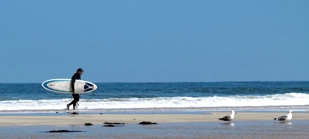 playa Villaviciosa Asturias surfer blue sea beach spain buy real estate property