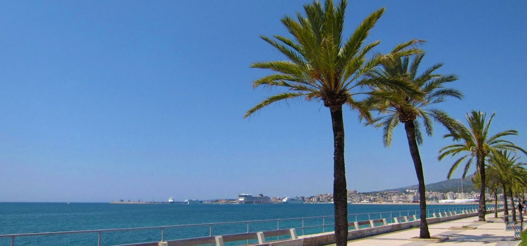 Ciudad Jardin El Molinar Portitxol Portixol area of Palma de Mallorca with view over Porto Pi with cruise ships and palms sea living in Spain
