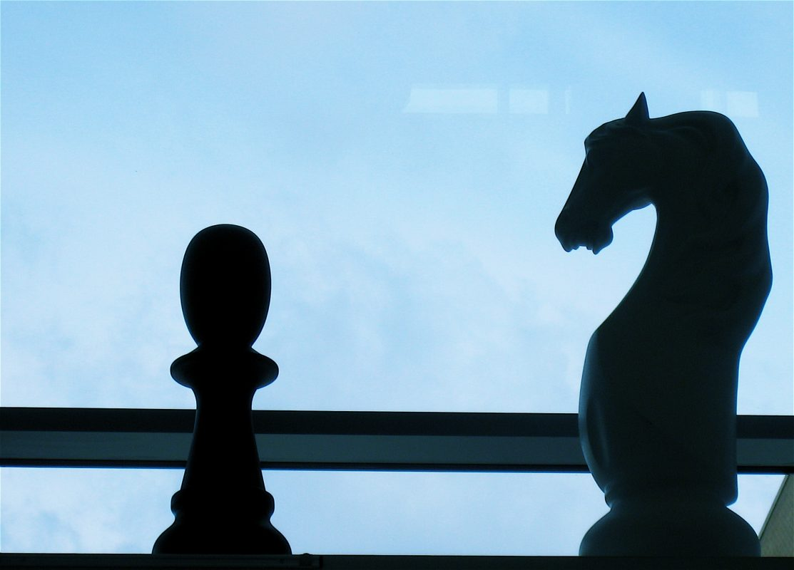 Close-up of two chess figures.