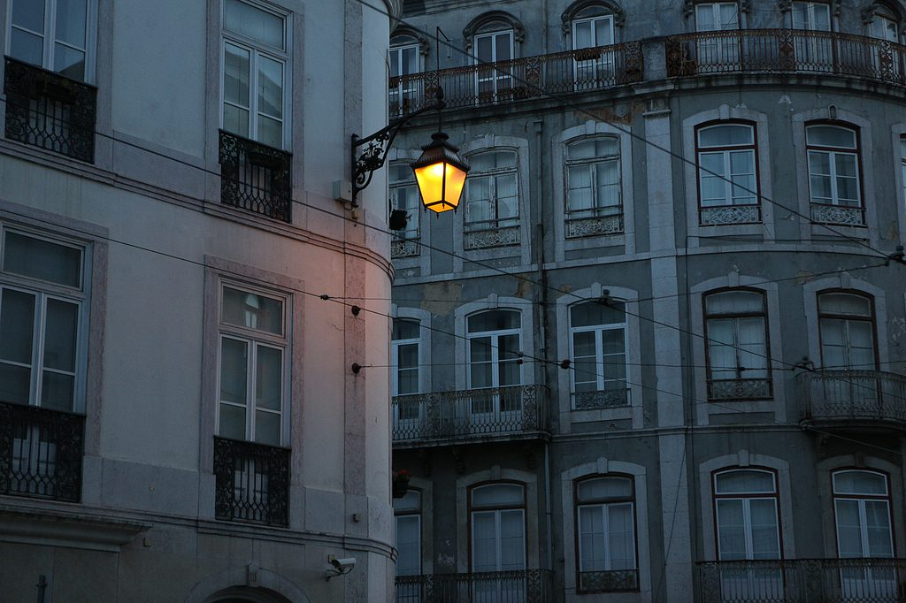 a single lamp glooming during the night in Lisbon