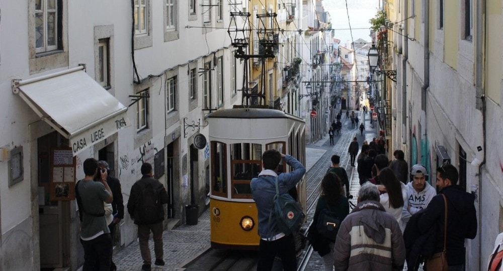 bairro alto people yellow tram misericordia property guide by casafari portugal