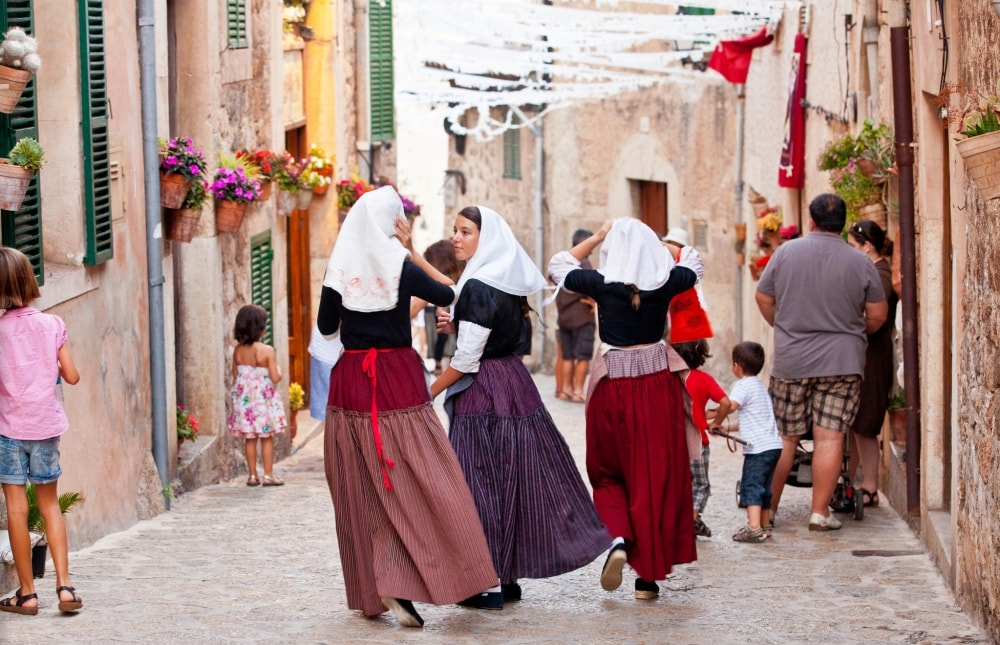 Lively streets of Valldemossa property market, Beata festival.