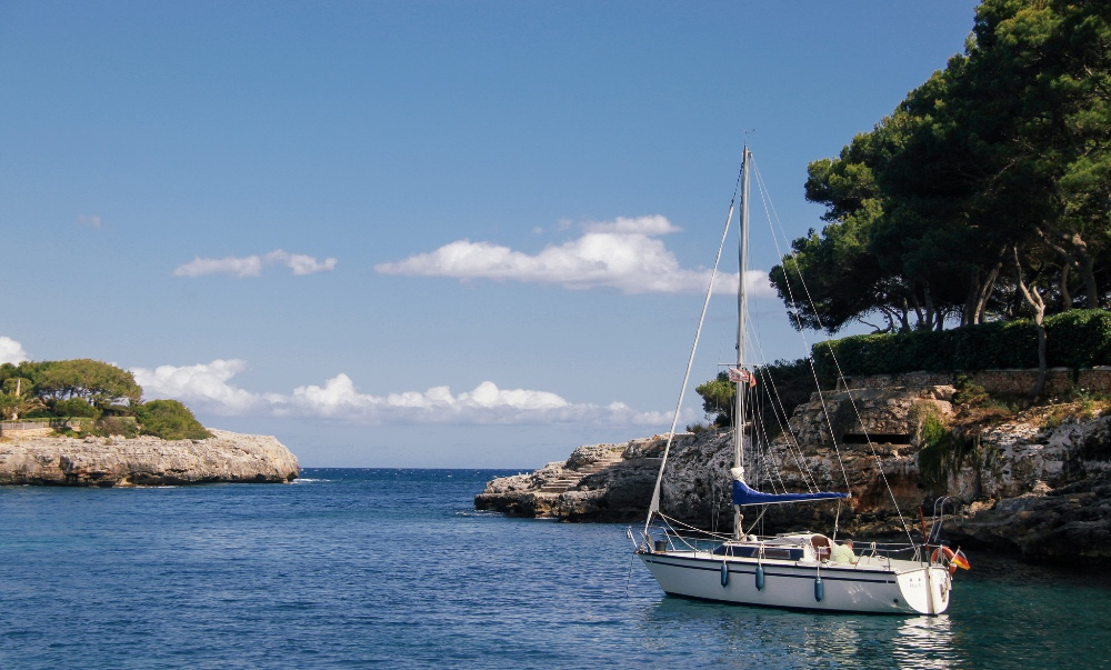 cala d or yacht blue sea pine trees santanyi mallorca