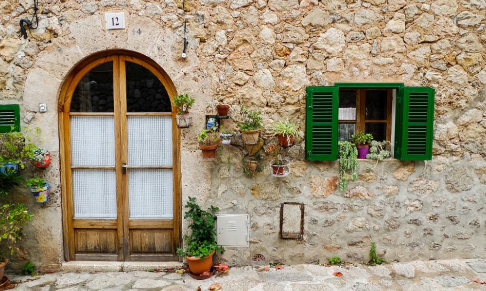 traditional house with green windows valldemossa