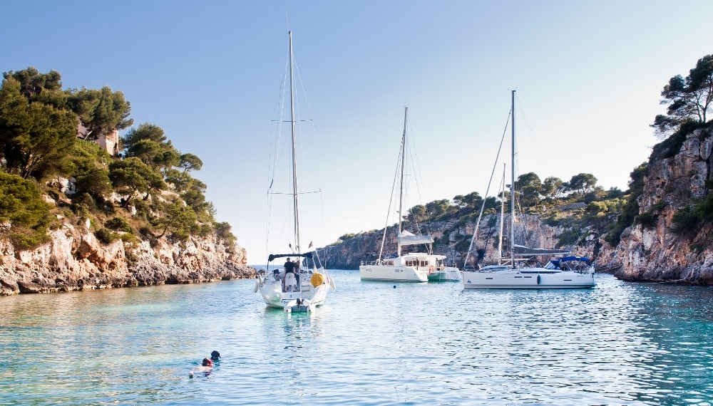 Cala Pi property owners on yachts and boats.
