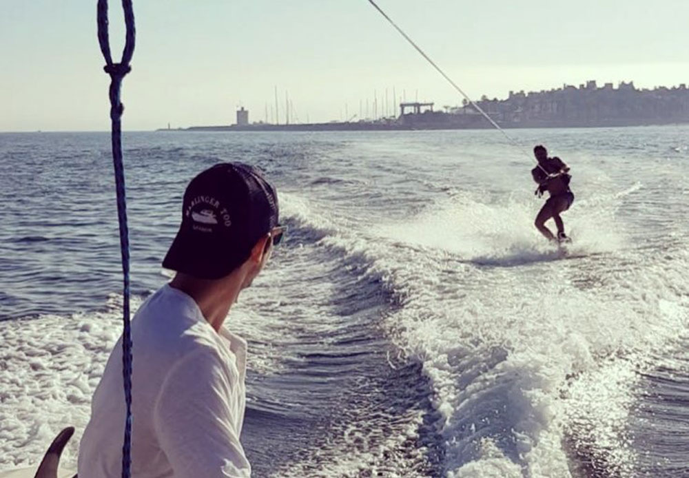 Wakeboarding with Sotogrande Marina property market in the background.
