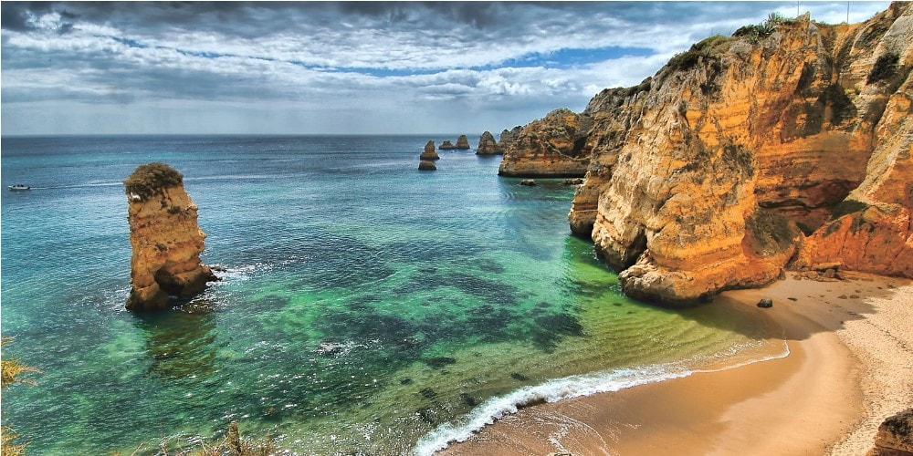 beautiful beach in algarve property guide by casafari portugal-min